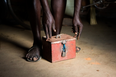 Savings lock box, Uganda. Photo by Allison Shelley for CGAP.